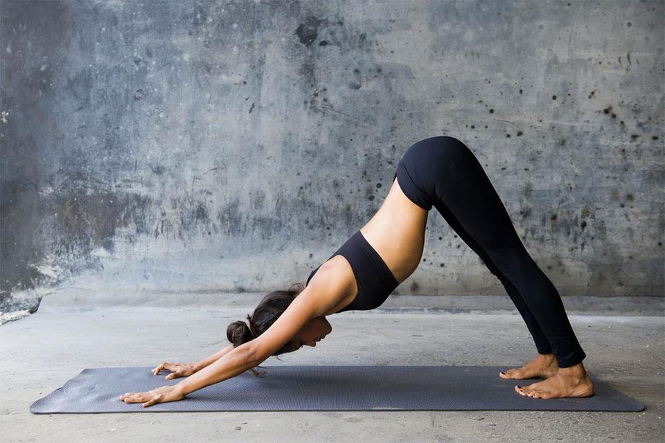 Pose example from Ashtanga Yoga - Downward-facing Dog Pose in studio.