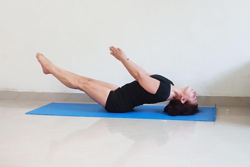 Woman in Iyengar Yoga pose on mat.