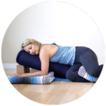 Restorative Yoga Post Example - Woman laying on side with blocks and bolsters